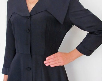 The 1950's Black Ribbed Taffeta Fitted Dress