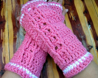 soft pink fingerless gloves with white trim and cable decoration