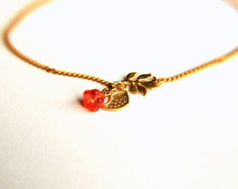 Gold Plated Bracelet:  Tiny twitter bird, leaves and pink spring blossom a nice gift for mothers day valentines christmas wedding