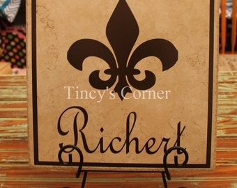 Ceramic Tile Name Plate with Last Name, Fleur de lis, and a Square Border - 12 inch