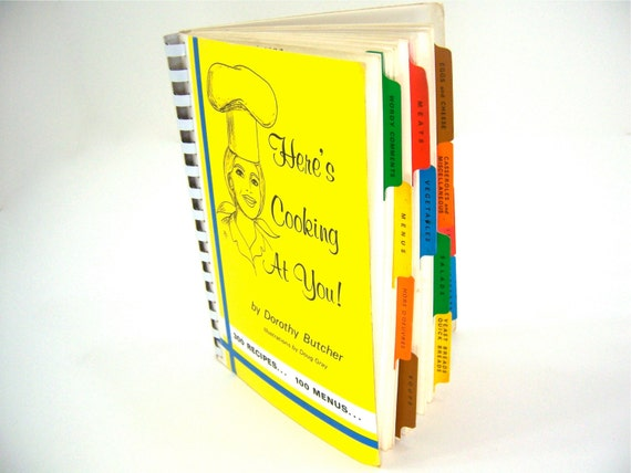 Yellow cookbook with colorful tabs, vintage wedding shower kitchen gift idea for men and women by Dorothy from over the rainbow in Kansas.