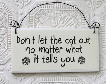 Funny Warning Sign  Don't Let The Cat Out No Matter What It Tells You