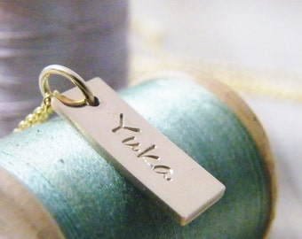 tiny gold name tag necklace personalized in 14kt gold fill