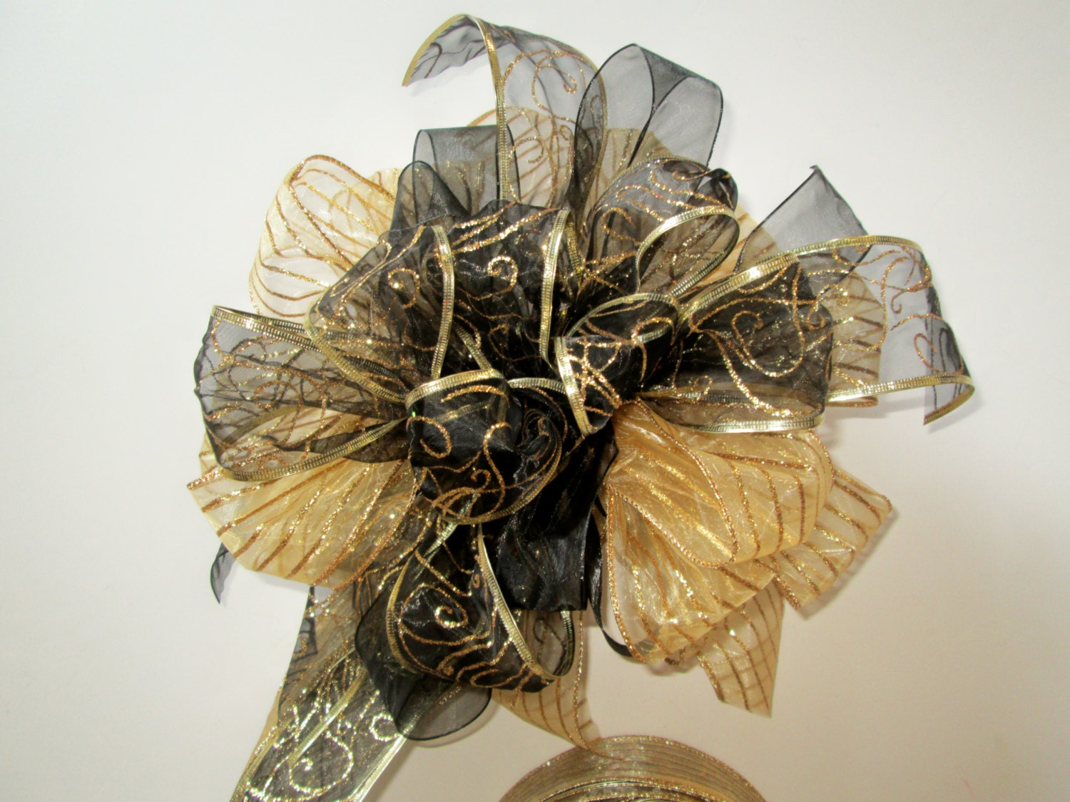 On sale black and gold christmas tree topper bow modern tree for Modern gold christmas tree