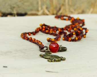 Dragon charm beaded wrap bracelet/ necklace. Boho tribal jewelry.  Amber Orange, carnelian  brown
