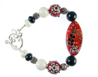 Lampwork Bracelet Featuring Red, Black and White Glass Flower Beads