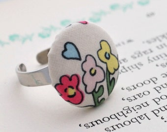Button ring in silk flower fabric