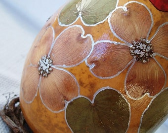 Medium natural gourd box, dogwood flowers, rust lid.  1075.