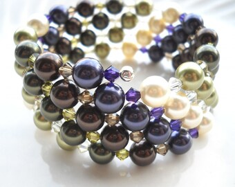 Green and purple Swarovski wrap bracelet: Dare We Drink What We Found There? - green pearls, purple pearls, memory wire, dark purple