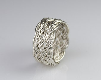 Hand-tied silver wire Turks Head Knot ring with a twist