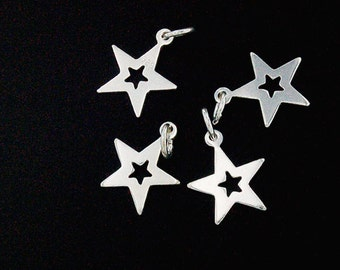 4 of 925 Sterling Silver Star Charms 10 mm. :th1563
