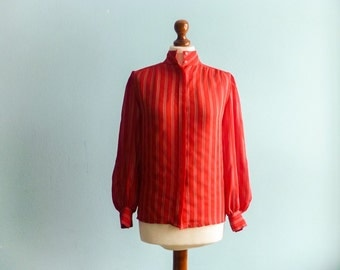Vintage coral red secretary blouse / vertical stripes / semi sheer / high neck / long sleeves / buttoned / medium