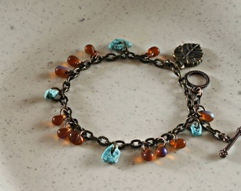 Morning Dew Bracelet Turquoise Czech frosted tear drop and leaf charm from ARANYA Collections