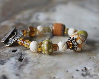 antique gold brown green ivory lampwork bracelet