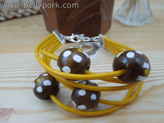 Yellow leather cuff , with wood beads. Yellow leather bracelet.
