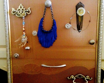 Framed Jewelry holder with old knobs