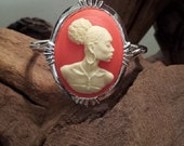 Cameo of Nubian in Coral Tone Resin.