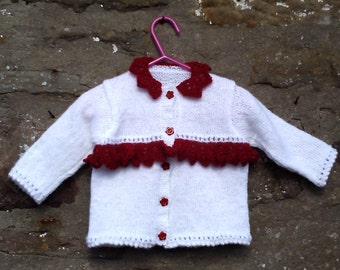 """Hand knitted baby girls glitter white and red cardigan and hat set. 20"""" chest."""