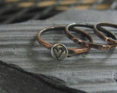 Three Stacking ring. SIZE 8 One of Them with a Stamped Heart.
