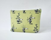 Woman's padded travel make up pouch gothic poisonous potions beauty products print in khaki green and black. in large.