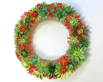 Abigale 12 inch burlap wreath with bright orange, shades of green flowers woven in vintage Swistraw by Ruby Buffalo.