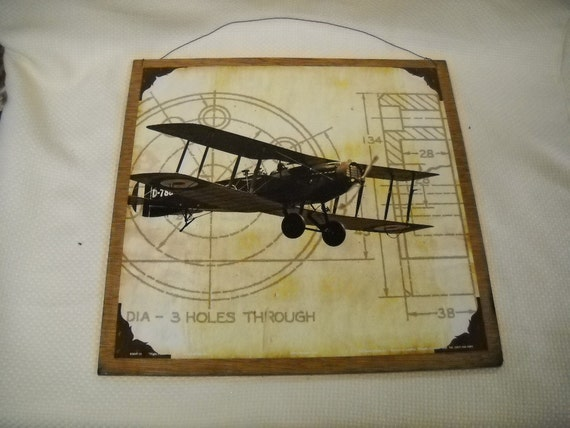 Wooden Airplane Wall Decor : Holes through airplane wooden wall art by