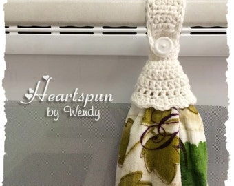 White hand or dish towel holder with ruffle skirt, great for holding towels in the kitchen, bathroom, garage, laundry, nursery