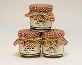 1 mini 2 oz. mason jar with rustic red gingham fabric, twine bow, and a label! So cute for a winter or fall wedding!