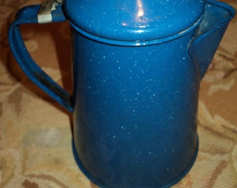 Vintage Blue Enamel Covered Coffee Kettle with Handle and Attached Lid in vintage condition with well developed patina.
