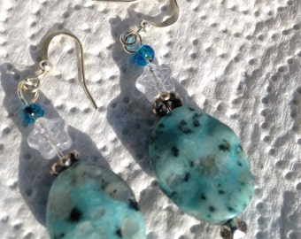 Blue stone look beads with a flower accent earrings