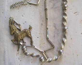 Carnival brass horse necklace