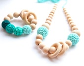 Set of 2. Mint nursing rings necklace and shade of mint teal teething ring toy.