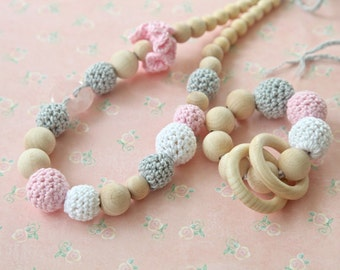 Pink and grey set of 2. Teething ring toy and nursing necklace. Light pink, white, grey rattle for baby and mom.