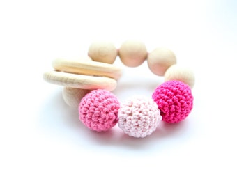 Teething toy with crochet wooden beads and 2 wooden rings. Pink, rosa wooden beads rattle.