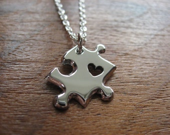 A Miniature Puzzle Charm with Heart, Silver