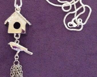Darling silver bird and bird house necklace.