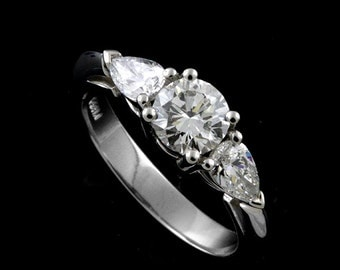 Platinum Round 0.70ct Diamond with Pear Shape Side Stones Modern Engagement Ring