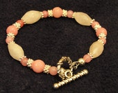 """6 5/8""""Rose quartz and Morganite bracelet with silver toggle clasp"""