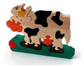 Wood Toy Puzzle COW. Handmade puzzle game that develops motor skills. Kids toy. Wooden eco friendly toys for children.