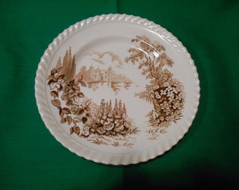 "One (1), 6 1/4"" Bread & Butter Plate, from Johnson Bros., in the Castle On The Lake-Brown Pattern."