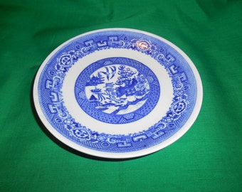 """One (1), 6 1/8"""" Tea Cup Saucer, from Homer Laughlin, in the Blue Willow Pattern."""