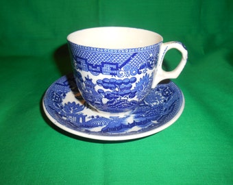 One (1), Made in Japan, Tea Cup and Saucer, in the Blue Willow Pattern.