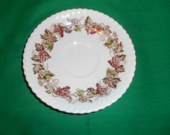 One (1), Tea Cup Saucer, from Johnson Bros., in the Empire Grape Pattern.