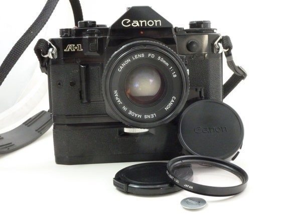WORKING Classic Canon A-1 Camera w/50mm 1.8 Prime Lens, Power Winder, Lens Cap, Filter, Strap,