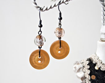 Orange button and bead dangle earrings
