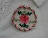 Embroidered Brooch - pink cross stitch flower framed by couching re-purposed vintage linen by Lynwoodcrafts