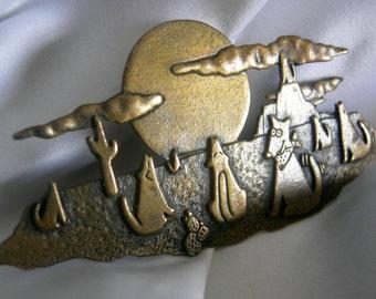 Brass Toned Desert Scene with Wolves and Moon Brooch signed JJ JONETTE - Vintage