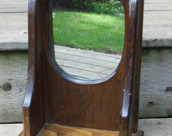 Small oval mirror with shelf
