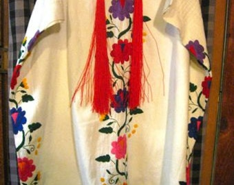 SALE Gorgeous Mexican Huipil featuring Floral Designs and long Red Tassels