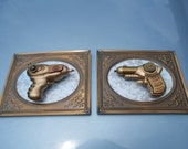 Pair of steampunk guns on vintage brass frames